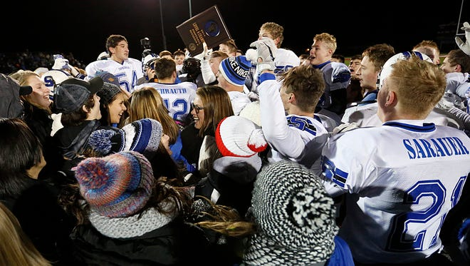 St. Mary's Springs Academy football players and fans celebrate after beating Markesan Friday November 3, 2017 in a WIAA division 6 semi-final playoff game in Slinger. Springs won the game 21-9 and advance to the state championship game Thursday November 16 in Madison. Doug Raflik/USA TODAY NETWORK-Wisconsin