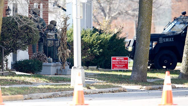 Fond du Lac police and SWAT team members search a house Sunday morning in the 100 block of Western Avenue for a suspect wanted in an overnight shooting of a 31-year-old Fond du Lac man.