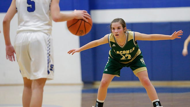 Laconia's Haley Rens defends against St. Mary's Springs Academy's Nicole Lavey on Thursday in Fond du Lac.