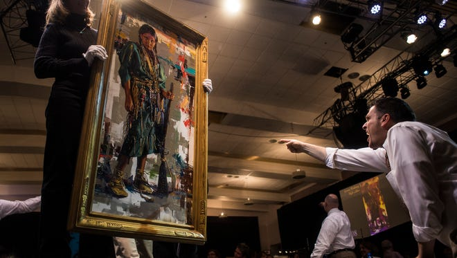 """Jeremy Winborg's """"High-caliber"""" sold for $45,000 during the 50th Russell Auction in the Mansfield Convention Center Saturday. It was expected to go for $9,200 at the highest."""