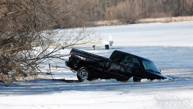 The Fond du Lac County Sheriff's Department dive team assisted the Dodge County Sheriff's Department Monday to search for anyone who may have been underwater near where a pick-up truck had gone through the ice on Beaver Dam Lake near Hickory Point Road.