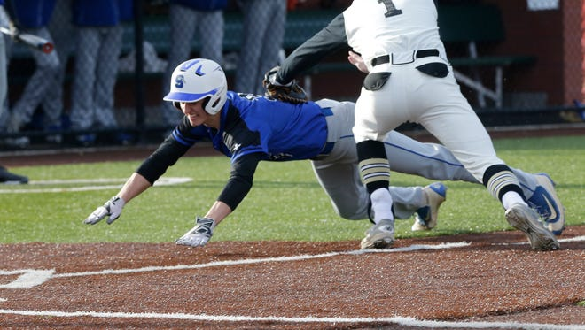 Waupun's Caleb Sauer tags out Mitch Waechter of St. Mary's Springs at home plate during Tuesday's game in Waupun.