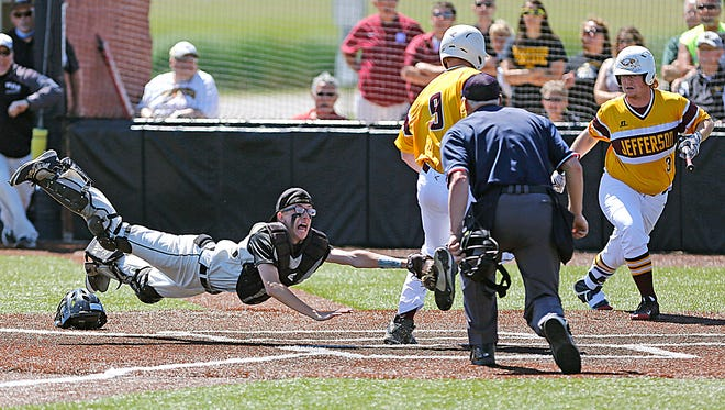 Waupun High School baseball's Bryce Burmania attempts to tag out Jefferson High School's Zack Peterson at home plate Tuesday June 6, 2017 in Waupun during their WIAA Division 2 sectional semi-final game. Peterson ended up scoring the only run for Jefferson as Waupun beat them 2-1. This photo won Photographer Doug Raflik a first place award in the sports photo category of the Wisconsin Newspaper Association's 2017 Better Newspapers Contest.