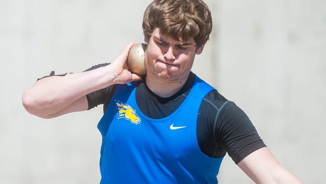 Great Falls Central's Noah Ambuehl throws in the shot put competition during the District 10C-1B Track and Field meet at Memorial Stadium Saturday.