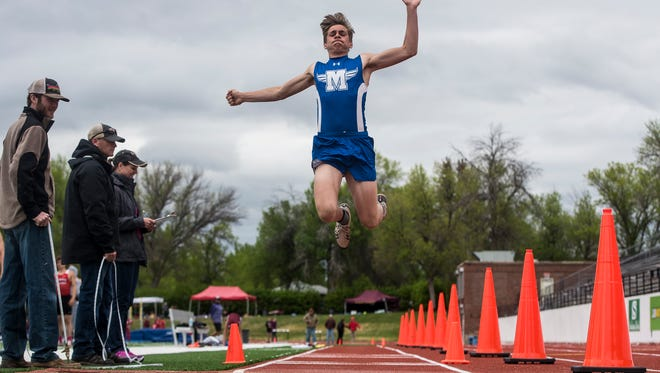 Malta's Benn Cormac competes in the boys' long jump during the District 1 and 2B Track and Field Divisional Championships at Memorial Stadium Saturday.