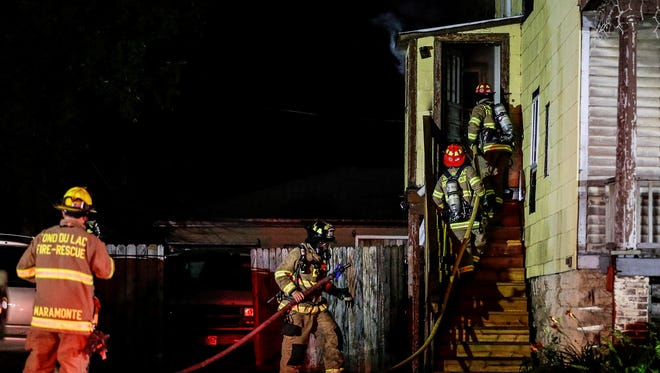 Fond du Lac firefighters battle a blaze Friday night at a residence on East Johnson Street, believed to be caused by careless use of smoking materials.