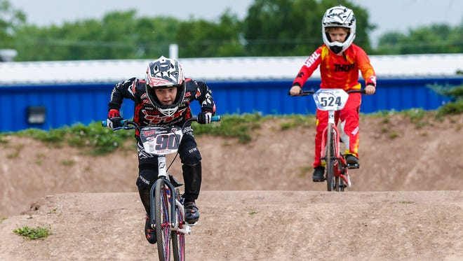 Cameron Baitinger and Jake Repenshek ride the track Thursday, June 21, 2018, at the Fond du Lac BMX Club in Fond du Lac.