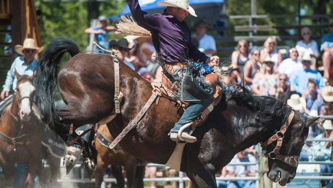 Jesse Kruse rides Coast Guard during Saddle Bronc competition at the Augusta American Legion Pro Rodeo Sunday. He won with 84 points.