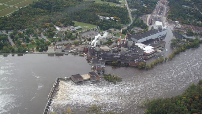 NewPage mill at Biron during flooding in 2010. NewPage has announced it intends to sell the mill to a Canadian paper company.