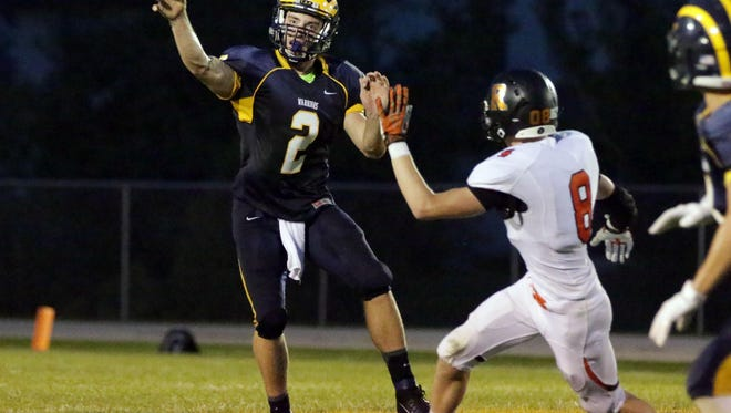 Quarterback Joe Lippe (7) is hoping to lead Ozaukee to its first Level 3 playoff appearance in school history when the Warriors host Iola-Scandinavia on Friday.