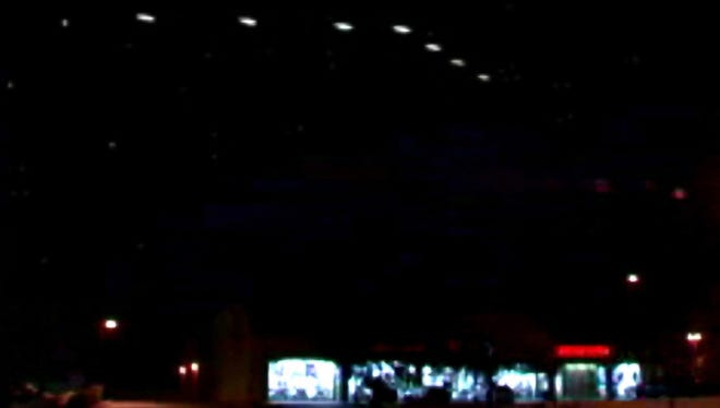 """The """"Phoenix Lights,"""" as they appeared to Lynne D. Kitei's video camera on the evening of March 13, 1997."""