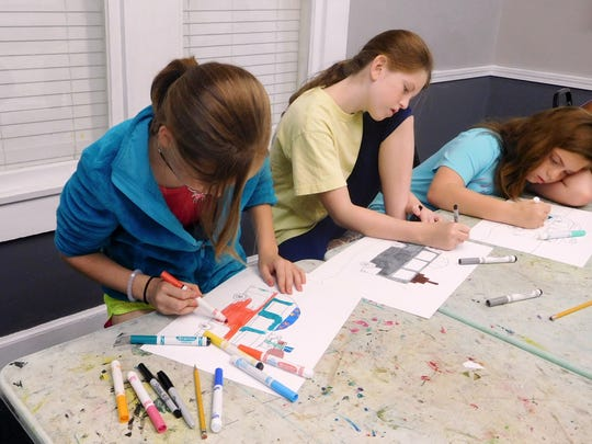 Campers creating mixed-media artworks.