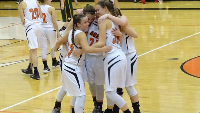 Amanda-Clearcreek seniors, Maddie Snider, Michaela Sahr, Jaidee Collins, Haley Hedrick and Maria Black, hug as they are taken out of the game Friday against Hamilton Township. The Aces clinched the outright Mid-State League-Buckeye Division championship.
