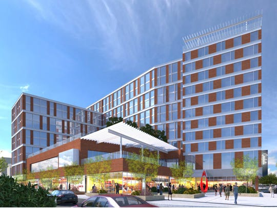 A rendering of the 12-story hotel and apartment complex