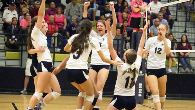 The Coronado volleyball team, including Carolina Mendez, 3, Charlotte Brown, 11 and Elyse Benavides, 12, celebrate their hard fought victory over Westside rival Franklin Tuesday night at Coronado.