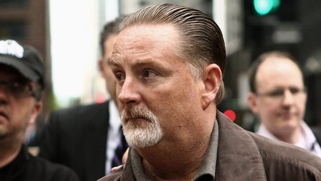 In this May 14, 2014 photo, former Chicago transportation official John Bills leaves the federal building in Chicago after being arrested on suspicion of allegedly taking cash and gifts to steer more than $100 million to Phoenix-based Redflex Traffic Systems Inc.