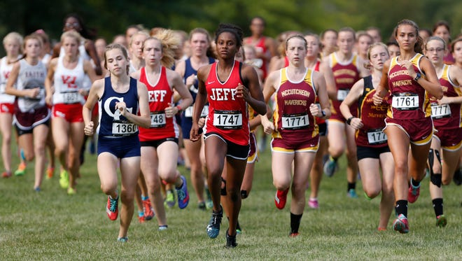 Runners take off at the start of the girls race of the City/County cross country meet Tuesday, August 29, 2017, at the Tippecanoe Amphitheater.