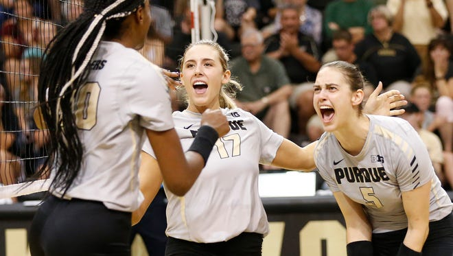 Danielle Cuttino, from left, Blake Mohler and Ashley Evans of Purdue celebrate a point against Indiana in the second set Wednesday, September 27, 2017, at Holloway Gymnasium on the campus of Purdue University. Purdue swept rival Indiana 25-16, 25-14, 25-15.
