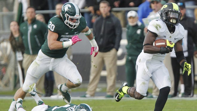 Akeem Hunt breaks free for a touchdown at 8:49 in the fouth quarter against Michigan State Saturday, October 11, 2014, at Ross-Ade Stadium. Michigan State defeated Purdue 45-31.