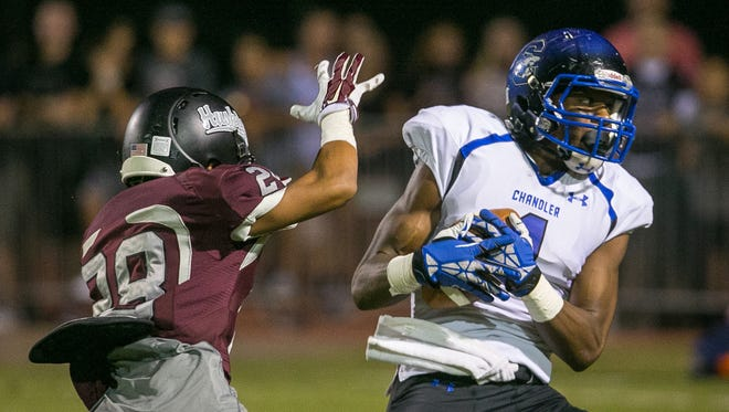 While carving out a pretty good basketball season, Chandler junior wide receiver N'Keal Harry's football recruiting is heating up.
