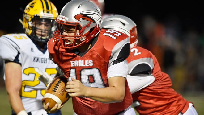 Dover quarterback Justin Johnson carries the ball against Eastern York on Friday.