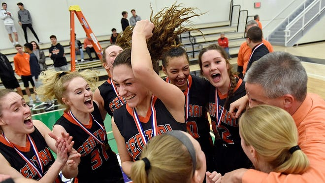 The Central York girls' basketball team celebrates its second straight YAIAA title Friday night at York College.
