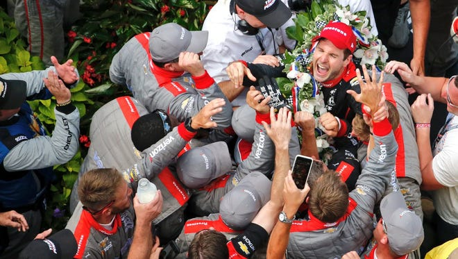 Will Power and crew celebrate winning Sunday's Indianapolis 500.