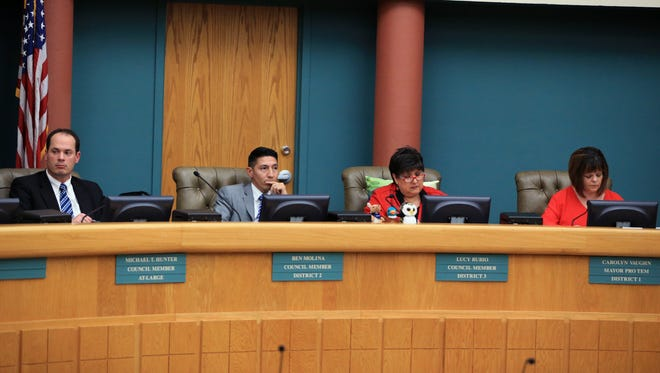 City Council members Michael Hunter, Ben Molina, Lucy Rubio and Mayor Pro-Tem  Carolyn Vaughn listen as a resolution is read before voting on it to exclude former council member Mark Scott from the ballot in the upcoming mayoral special election on Friday, March 10, 2017 at City Hall.