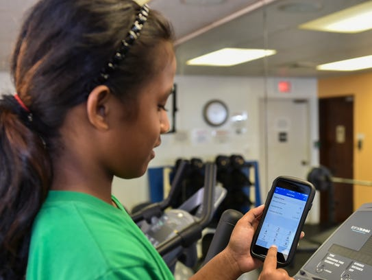 Inaisha Inais, 11, inputs her calorie data into the