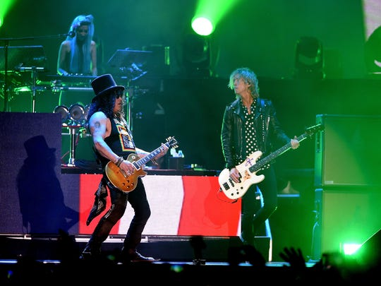 Slash (left) and Duff McKagan of Guns N' Roses perform onstage during at the Coachella festival in April.