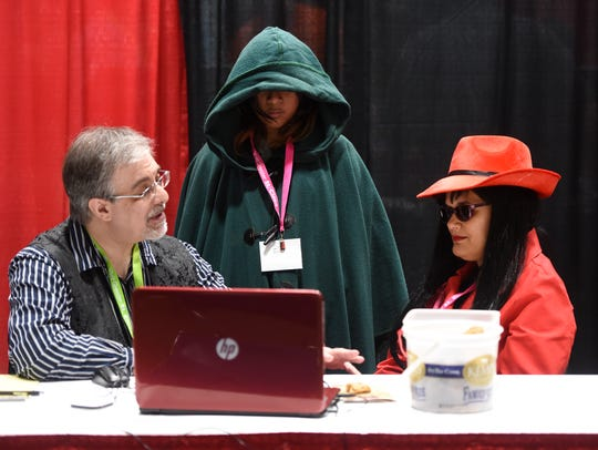 Cory Strode conducts a podcast interview during LionCon