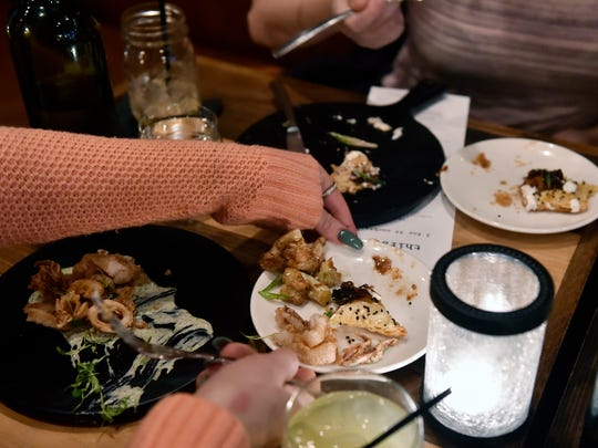 A trio of Restaurant Week York-menu appetizers gets passed around at Revival Social Club Saturday, Feb. 24, 2018, in York. The eighth annual Restaurant Week York kicked off Friday and runs through March 3, with more than 30 restaurants participating.