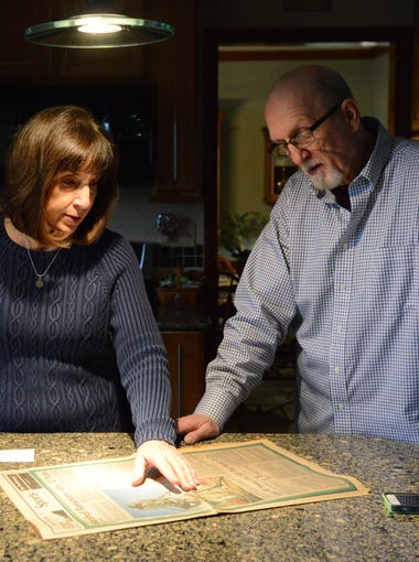 Dennis Foley, right, and his wife Debbie Foley stand at the kitchen counter of their Pickerington home. Dennis Foley played for the 1969 Marshall University Thundering Herd football team. An offseason injury forced him off the 1970 team and the ill-fated plane flight that resulted in the deaths of the 75 people including most of his teammates.
