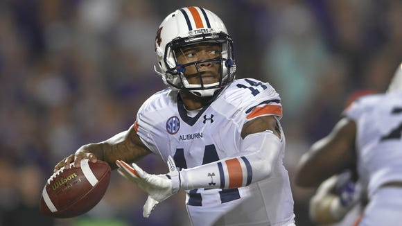 Auburn quarterback Nick Marshall passes during the Tigers? 20-14 victory over Kansas State on Thursday. Auburn Tigers quarterback Nick Marshall (14) throws the ball against Kansas State during an NCAA college football game Thursday, Sept. 18, 2014 in Manhattan, Kan. (AP Photo/Reed Hoffmann)