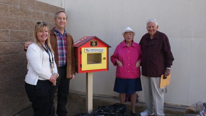 Pictured from left are Ann Morales, Sunrise Rotary member and principal of Amelia Earhart Elementary School; David Karlquist, principal of James Madison Elementary School; Lois Whitney, storyteller extraordinaire; and Bob Schneck, Sunrise Rotary member.