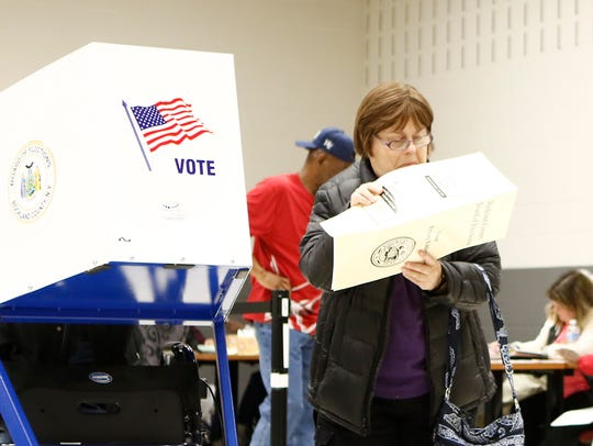 A voter looks over her ballot at the Rockland County