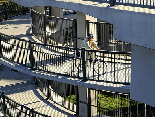 A bicyclist makes his way up the helix on the Sauk