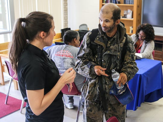 Reggie Felton, who was a leader at the tent city under the Houston Harte Expressway, talks to Amanda Cruz during a social service assessment event Friday, June 2, at the Salvation Army.