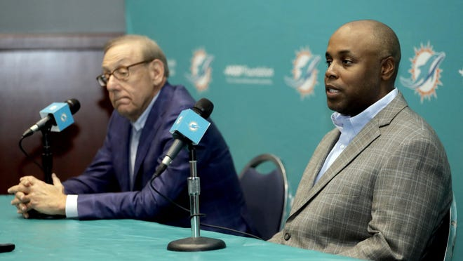 Miami Dolphins owner Stephen Ross, left, signs the checks. And general manager Chris Grier, right, has been spending the money wisely.