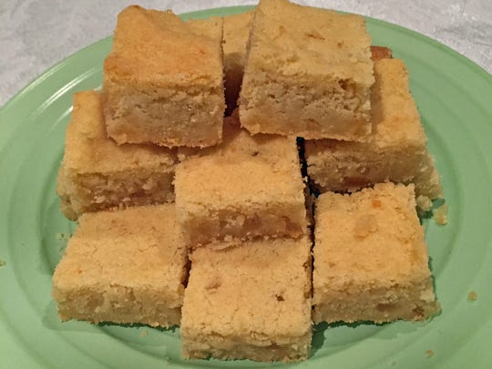 The cake, really a shortbread-like cookie, is cut into small squares.