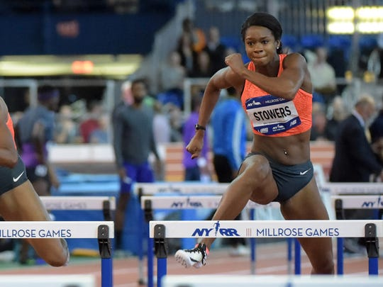 Feb 20, 2016; New York, NY, USA; Janay DeLoach-Soukup (USA) (left) defeats Brianna Rollins (USA) (middle) and Jasmin Stowers (USA) to win the womens 60m hurdles in 7.85 during the 109th Millrose Games at The Armory. Mandatory Credit: Kirby Lee-USA TODAY Sports