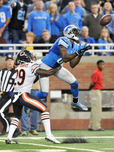 Lions wide receiver Calvin Johnson holds on to a catch