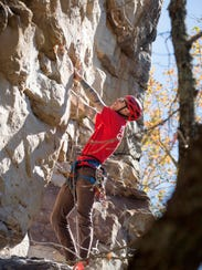Andy Knepshield of Nashville surveys a climbing route