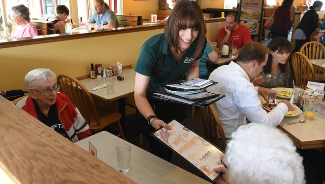 Brittney Shell waits tables at The Egg and I Tuesday in Fort Collins. Many restaurant owners oppose a proposed amendment to increase Colorado's minimum wage to $12 an hour by 2020.