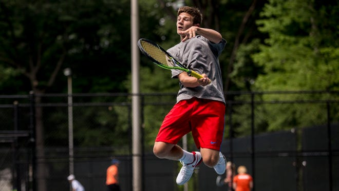 Troy Distelrath, 16, of St. Clair, jumps in the air to return the ball during the Francis J. Robinson Memorial International Tennis Tournament Friday, August 5, 2016 at Sanborn Park in Port Huron.