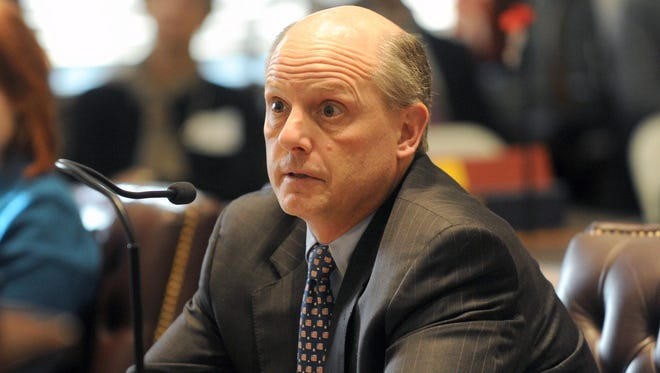 Delaware Supreme Court Chief Justice Leo E. Strine Jr. says three major police forces should join to combat crime in northern Delaware. However, Gov. Jack Markell and Wilmington's mayor are against the idea.
