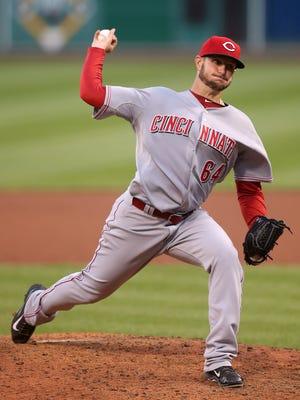 Cincinnati Reds starting pitcher Josh Smith (64) pitches.