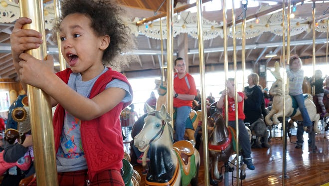Gabriella Mickouma, 5 years old, enjoys her ride at the Richland Carrousel Park as she celebrated Martin Luther King, Jr. Day with many other children Monday morning.