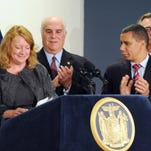 In this file photo from 2010, Gov. David Paterson applauds Carol Fitzgerald, CEO and president of Life Medical Technologies, for bringing her company to Dutchess County during a press conference at the Hudson Valley Research Park in East Fishkill. Standing behind them, from left, are County Executive William Steinhaus and Empire State Development Chairman and CEO Dennis Mullen.