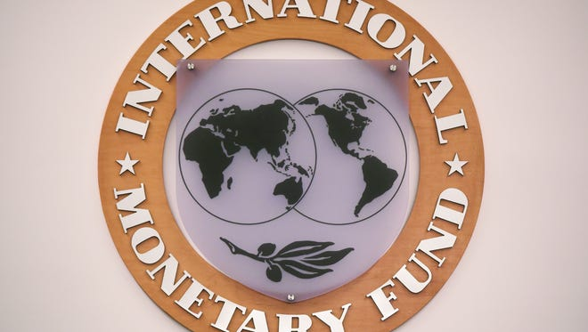 The seal of the International Monetary Fund inside IMF headquarters in Washington, D.C.
